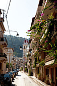 Alley with bougainvillea and church in Zante, Zakynthos city, Zakynthos, Ionian Islands, Greece