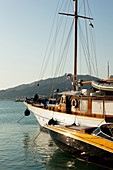 Sailing ship and motorboat in the harbor in the evening light, waterfront, Zante, Zakynthos city, Zakynthos, Ionian Islands, Greece