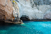 Cliffs and caves at the sparsely populated western coast of Zakynthos, Zakynthos, Ionian Islands, Greece