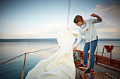 9 year old girl on the foresail of the 2 Master Sir Shackleton, Ammersee, Bavaria Germany
