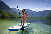 2 girls on SUP, Bohinj Lake, Triglav National Park, Slovenia