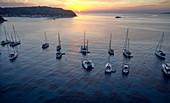 Sailboats in buoy field in front of Susak island, Kvarner bay, Adriatic sea, Croatia
