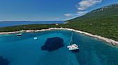 Catamaran at anchor Bay of Tomozina, Cres, Croatia