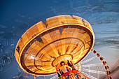 Long exposure of illuminated chain swing ride