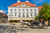 A horse drawn carriage in the New Town, Warsaw, Poland, Europe