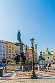 The Adam Mickiewicz Monument in the main Square in the medieval old town, UNESCO World Heritage Site, Krakow, Poland, Europe