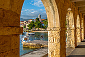 View of town and harbour through arches in Cavtat on the Adriatic Sea, Cavtat, Dubrovnik Riviera, Croatia, Europe
