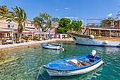View of harbourside restaurants in Cavtat on the Adriatic Sea, Cavtat, Dubrovnik Riviera, Croatia, Europe