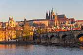 View from the banks of Vltava River to Charles Bridge, Prague Castle and St. Vitus Cathedral, UNESCO World Heritage Site, Prague, Bohemia, Czech Republic, Europe