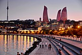 Evening view from the waterfront over Baku Bay to the Flame Towers with illumination, Baku, Caspian Sea, Azerbaijan, Asia