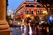 Evening at the Zocalo with colonial buildings and lights, Puebla, Mexico
