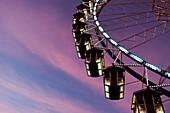 Ferris wheel at Oktoberfest at sunset; Munich; Germany