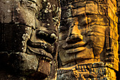 T wo of 216 smiling sandstone faces at 12th century Bayon, King Jayavarman VII's last temple in Angkor Thom, Angkor, UNESCO World Heritage Site, Siem Reap, Cambodia, Indochina, Southeast Asia, Asia