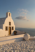 View of traditional white washed church at sunset in Oia, Santorini, Cyclades, Aegean Islands, Greek Islands, Greece, Europe