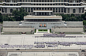Kim Il Sung Square, hordes of young people rehearsing marching routines prior to a grand parade, Pyongyang, North Korea, Asia