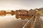 Boathouses at Kochelsee Lake at sunrise, Upper Bavaria, Bavaria, Germany, Europe