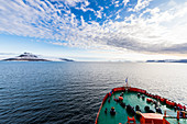 Icebreaker cruising through the flat table mountains covered with ice, Franz Josef Land archipelago, Arkhangelsk Oblast, Arctic, Russia, Europe