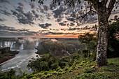 Scenic view of splashing†Iguazu†Falls and surrounding landscape at dusk, Parana, Brazil