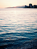 Tranquil scene with view of water in sea at sunset, Vancouver, British Columbia, Canada