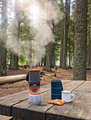 Steam coming out of camping stove standing on wooden table in†Mount Hood National Forest, Oregon, USA