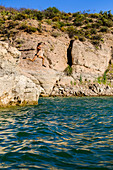 Girl jumps off cliff into Roosevelt Lake, Arizona.