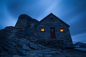 Exterior of stone house at night, Lake O'Hara, Yoho National Park, Alberta, Canada
