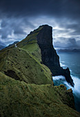 Majestic natural scenery with view of cliffs under dramatic sky, Kalsoy, Faroe Islands