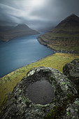 Majestic natural scenery with mountains and sea under dramatic sky, Funningur, Faroe Islands