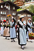 Women in traditional Swiss dresses on parade in Zermatt, Valais Canton, Switzerland