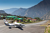 A small airplane is taking off from the famous airport of Lukla in the Nepalese Himalaya. The trek to Everest Base Camp (EBC) is possibly the most dramatic and picturesque in the Nepalese Himalaya. Not only will you stand face to face with Mount Everest, Sagarmatha in Nepali language, at 8,848 m (29,029 ft), but you will be following in the footsteps of great mountaineers like Edmund Hillary and Tenzing Norgay. The trek is scenic and offers ever-changing Himalayan scenery through forests, hills and quaint villages. A great sense of anticipation builds as you trek up the Khumbu Valley, passing