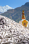 A Buddhist monument on the way to Everest Base Camp. Mani walls with mantras, a stupa and prayer flags. The trek to Everest Base Camp (EBC) is possibly the most dramatic and picturesque in the Nepalese Himalaya. Not only will you stand face to face with Mount Everest, Sagarmatha in Nepali language, at 8,848 m (29,029 ft), but you will be following in the footsteps of great mountaineers like Edmund Hillary and Tenzing Norgay. The trek is scenic and offers ever-changing Himalayan scenery through forests, hills and quaint villages. A great sense of anticipation builds as you trek up the Khumbu Va