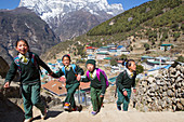 Four young children dressed in school uniforms are walking in hilly Namche Bazar, a mountain village in the Nepalese Khumbu valley. The trek to Everest Base Camp (EBC) is possibly the most dramatic and picturesque in the Nepalese Himalaya. Not only will you stand face to face with Mount Everest, Sagarmatha in Nepali language, at 8,848 m (29,029 ft), but you will be following in the footsteps of great mountaineers like Edmund Hillary and Tenzing Norgay. The trek is scenic and offers ever-changing Himalayan scenery through forests, hills and quaint villages. A great sense of anticipation builds