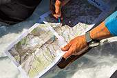 Hands of man holding map and planning ski route, Leavenworth, Washington, USA