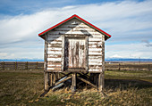 Old weathered stilt shed against clouds, Grass Valley, Oregon, USA
