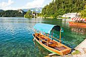 Wooden boat on shore of Lake Bled, Bled, Upper Carniola, Slovenia