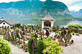Man digging grave in old graveyard in Hallstatt, Austria