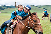 Young riders gather at Naadam Festival for horse race in Bunkhan Valley, Bulgan, Mongolia