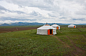 Mongolian yurt (ger) sleeping and recreational tents on steppe, Selenge Province, Mongolia