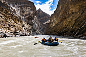 Adventurous people rafting in Zanskar River gorge, Ladakh Region, Jammu and Kashmir, India