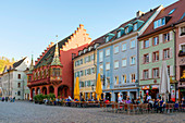 Historisches Kaufhaus (Historical Merchants Hall) on town square of Munsterplatz, built in 14th century, Freiburg im Breisgau, Baden-Wurttemberg, Germany
