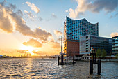 Elbe Philharmonic Hall (Elbphilharmonie) and buildings on Grasbookhafen harbor at sunset, Hamburg, Germany