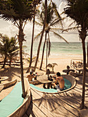 People enjoying beach at Papaya Playa Resort, Tulum, Mexico
