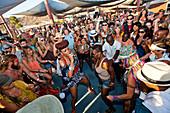 Singer performing inside crowd at music festival, San Bernardino County, California, USA