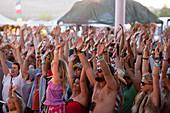 Crowd raising hands at music festival, San Bernardino County, California, USA
