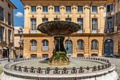 Historic fountain at Place d'Albertas in Aix en Provence, France