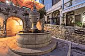 Medieval fountain of 1850 in Saint-Paul-de-Vence, Alpes-Maritimes, Provence-Alpes-Cote d'Azur, France, Europe