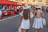 Attractive women in front of the trendy restaurant Senequir at the harbor of St. Tropez, Var, Cote d'Azur, southern France, France, Europe, Mediterranean Sea, Europe