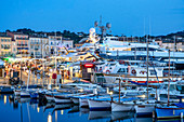 Fishing boats and luxury yachts in the harbor of St. Tropez, Var, Cote d'Azur, southern France, France, Europe, Mediterranean Sea, Europe