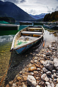 Old rowing boat at Sylvensteinsee in the background the Alps, Sylvenstein Reservoir, Bavaria, Germany