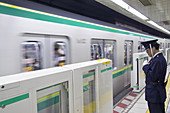 Conductor and Subway Train, Tokyo, Japan